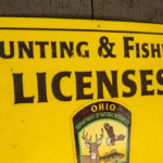 Hill N Dale Club Hunting and Fishing licenses sign